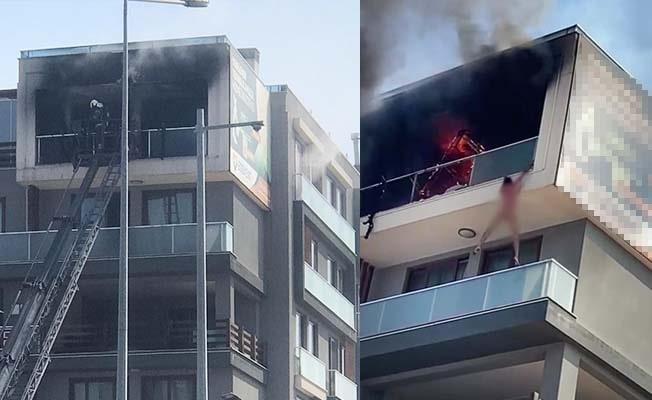 Alevlerden alt balkona atlayarak kurtuldu