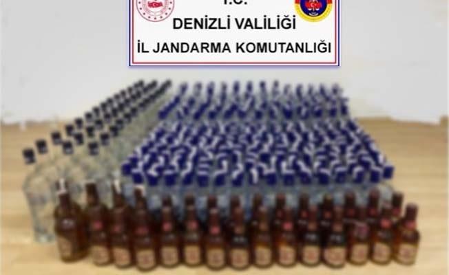 Jandarma bir evde 338 şişe alkol ve sahte bandrol ele geçirdi