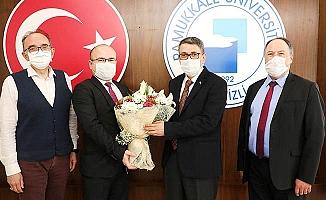 Rektör Vekili Kutluhan, Prof. Dr. Atar'ı makamında tebrik etti